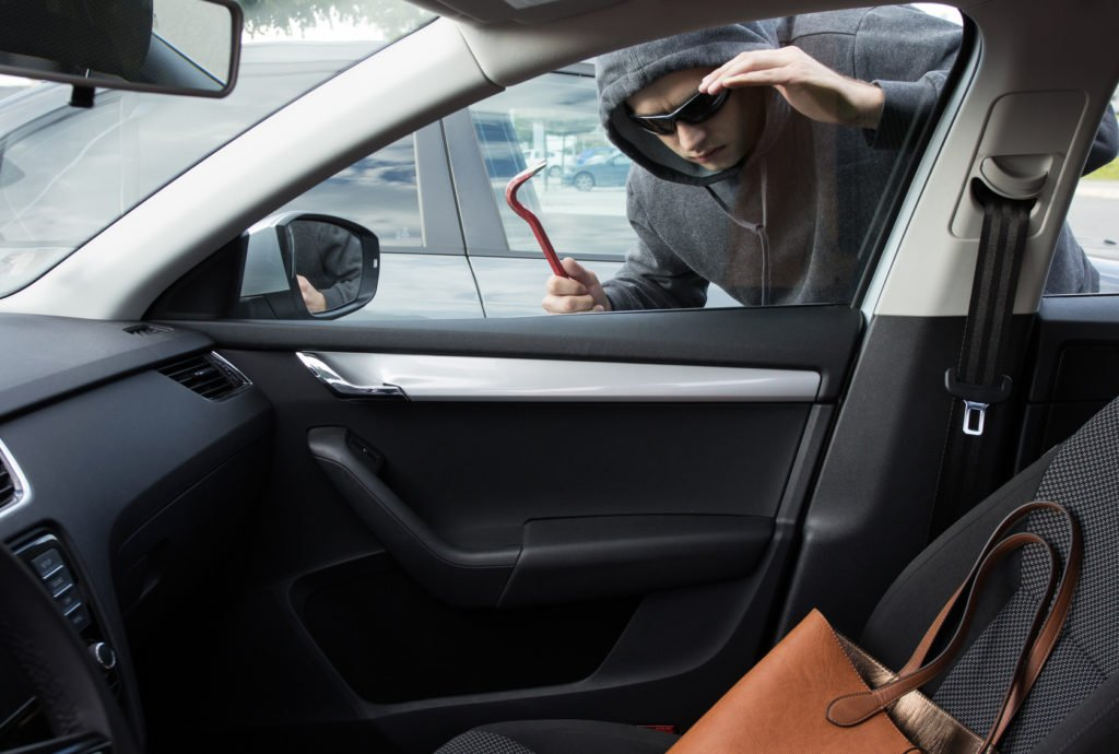 Thief is looking for unattended valuables left in a car