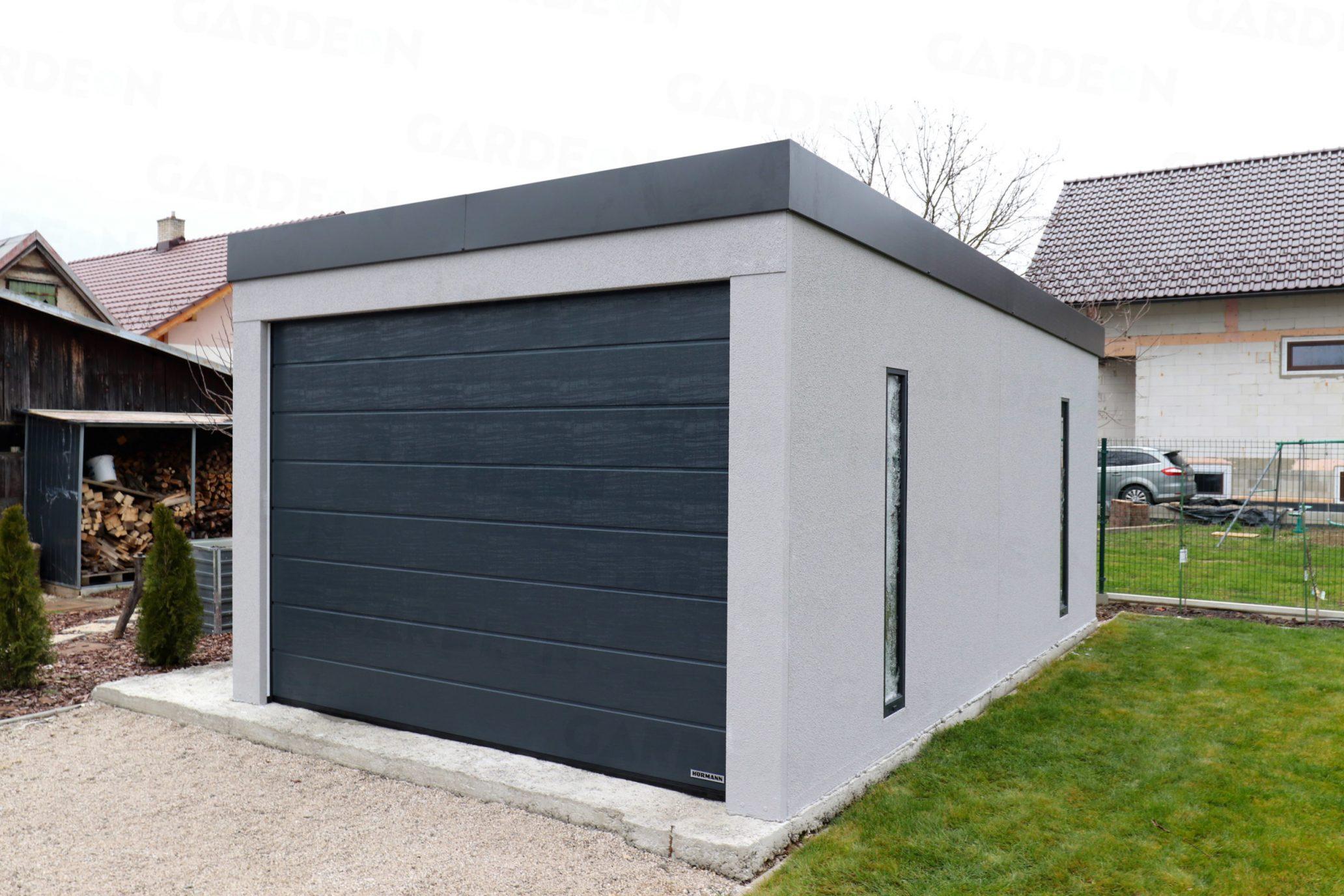 Jednogaráž v sivej omietke s rovnou strechou