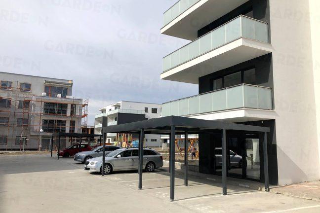 Prístrešok GARDEON pred modernou bytovkou