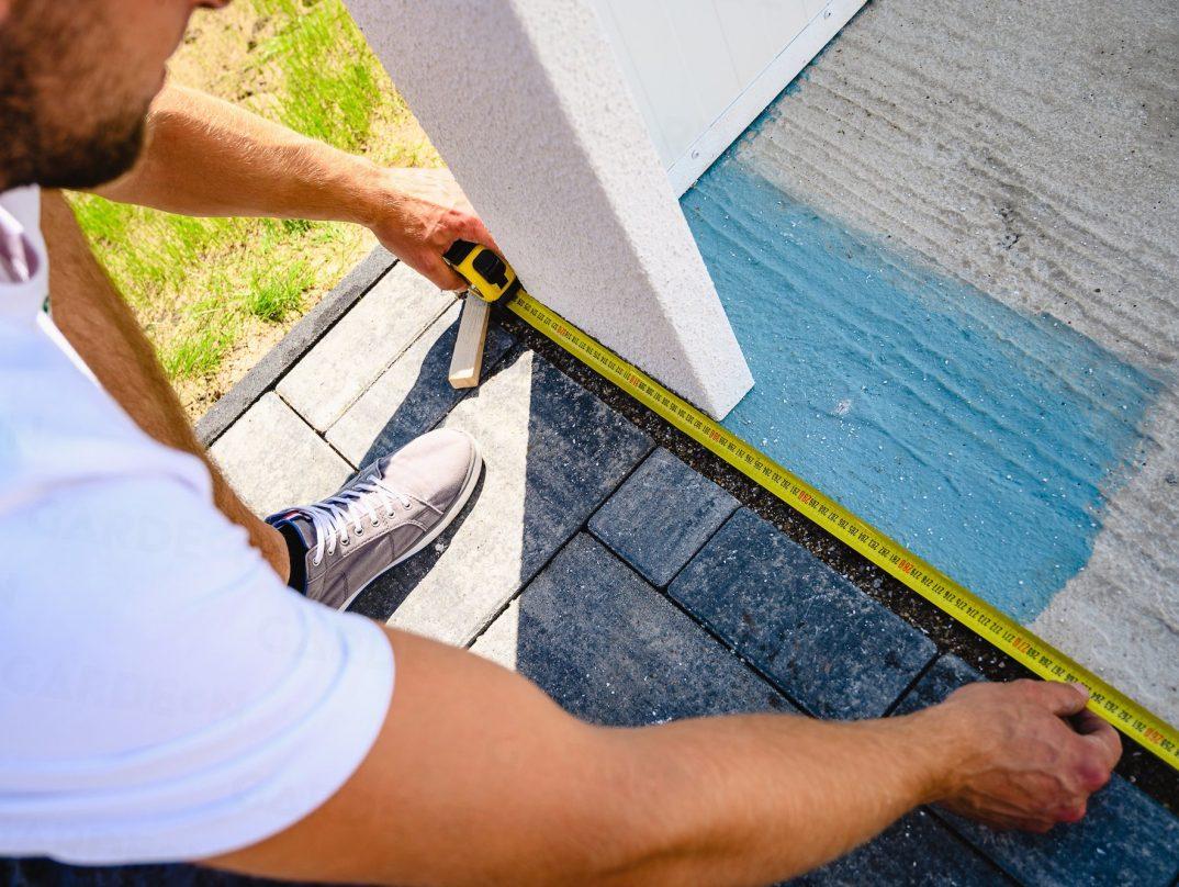 Meranie steny garáže