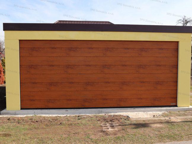 Montovaná garáž GARDEON pre dve autá v pieskovej omietke s bránou vo farbe zlatý dub